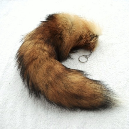 You get one real raccoon tail keychain with ball chain and split ring  attached with a grommet. These raccoon tails are real tanned fluffy tails  and are ... f3851cc5f266